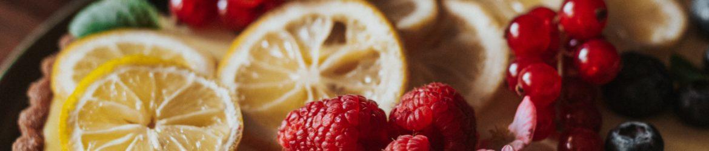 sliced lemon and strawberry on white ceramic plate