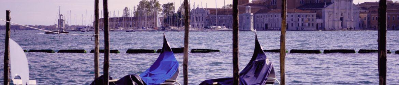 two gondola boats in a sea dock
