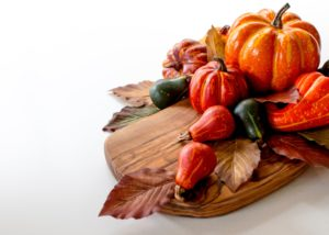 orange and green vegetable on brown wooden round plate