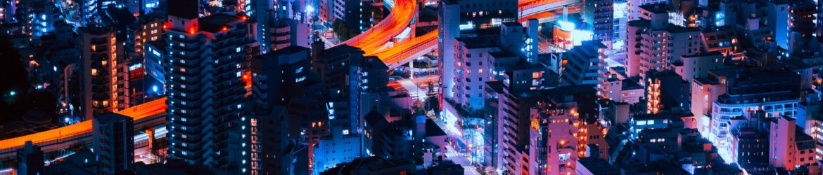 timelapse photography of vehicles and buildings