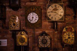 brown and white analog clock